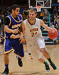 SIOUX FALLS, SD - MARCH 10:  Taylor Braun #24 of North Dakota State drives past Nelson Kirksey #1 of UMKC during their quarterfinal game at the 2013 Summit League Basketball Championships. (Photo by Dick Carlson/Inertia)