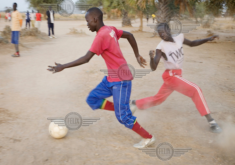 Footballers from the Turalei team train in the eary morning at the Twic Olympics in Wunrok, Southern Sudan.