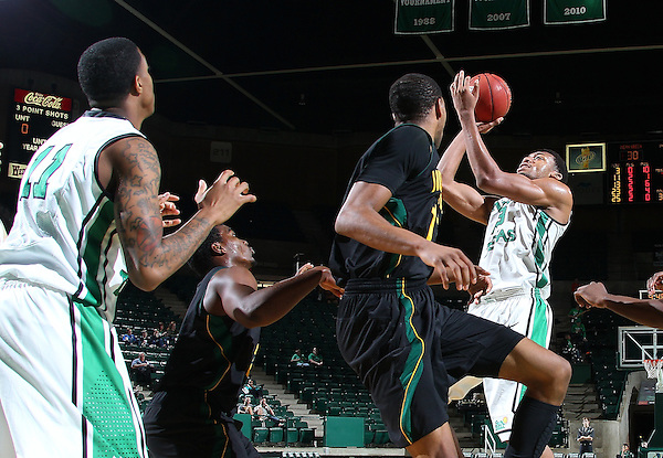 DENTON, TX - DECEMBER 16:  Tony Mitchell #13 of the North Texas Mean Green shoots over Antonnio Benton #11 of the Southeastern Louisiana Lions at the UNT Coliseum on December 16, 2012 in Denton, Texas. (Photo by Rick Yeatts/Getty Images)