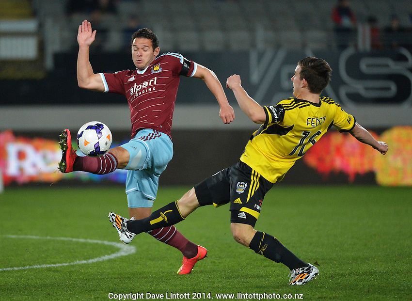 Matt Jarvis controls the ball under pressure from Louis Fenton during the Football United Tour match between Wellington Phoenix and West Ham United at Eden Park, Auckland, New Zealand on Wednesday, 23 July 2014. Photo: Dave Lintott / lintottphoto.co.nz