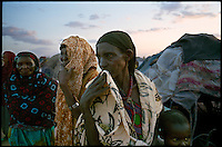 near El Wak, NE Kenya, March 2006.El Hachi IDP camp is home to thousands of 'drop-outs', semi-nomadic herdsmen who are leaving the bush to come and live in camps near villages as their livestock is decimated by a persistent drought, abandonning their traditional lifestyle.
