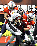 SIOUX FALLS, SD - JUNE 16:  Xavier Jordan #23 and Corey Johnson #96 from the Sioux Falls Storm put the clamps on Troy Harrison #5 of the Omaha Beef in the first quarter Saturday night at the Sioux Falls Arena. (Photo by Dave Eggen/Inertia)
