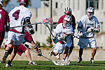 Los Angeles, CA 03/16/10 - Evan Snively (LMU # 4), Hayden Fulstone (LMU # 8) and Chase Parlett (LMU # 6) in action during the Chico State-Loyola Marymount University MCLA interdivisional game at Leavey Field (LMU).  LMU defeated Chico State 7-4.