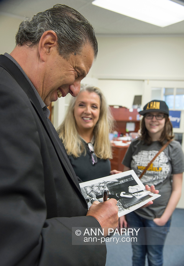 Garden City, New York, USA. April 17, 2016. JON BAUMAN, 'BOWZER', 69, a singer in the band and TV show Sha Na Na, drops by Canvass Kickoff for Democratic presidential primary candidate Hillary Clinton at the Nassau County Democratic Office. He autographed photos of himself as Bowzer for volunteers, and spoke about why it's important to GOTV, Get Out The Vote for Hillary Clinton. Bauman is an activist in electoral politics and public policy activist and co-founded Senior Votes Count, which focuses on senior issues.