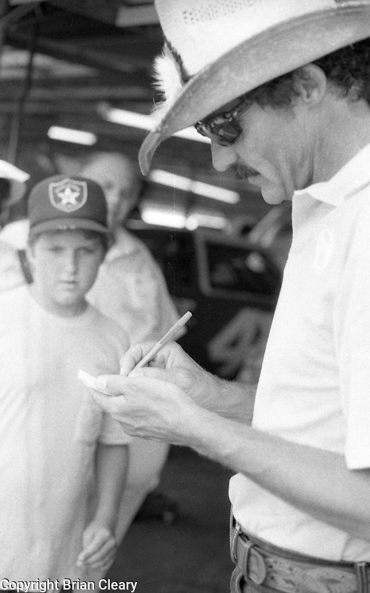 Richard Petty signs autograph Firecracker 400 at Daytona International Speedway in Daytona Beach, FL on July 4, 1983. (Photo by Brian Cleary/www.bcpix.com)