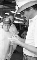 Richard Petty signs autograph Firecracker 400 at Daytona International Speedway in Daytona Beach, FL on July 4, 1983. (Photo by Brian Cleary/www.bcpix.com)