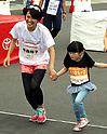 September 30, 2017, Tokyo, Japan - Special Olympics Nippon Foundation president Yuko Arimori (L) runs with a little girl at a charity run for the Special Olympics at Toyota's showroom Mega Web in Tokyo on Saturday, September 30, 2017. Some 1,800 people participated the charity event as Japan's Special Olympic Games will be held in Aichi in 2018.   (Photo by Yoshio Tsunoda/AFLO) LWX -ytd-