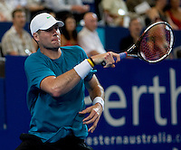 John isner (USA) against Leyton Hewitt (AUS) in a Group A match Australia V USA. Hewitt beat Isner 6-1 7-5..International Tennis - Hyundai Hopman Cup XXII - Tues 05 Jan 2010 - Burswood Dome - Perth - Australia ..© Frey, AMN Images, Level 1, Barry House, 20-22 Worple Road, London, SW19 4DH
