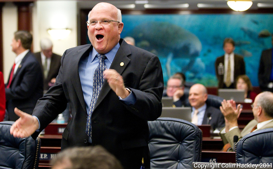 TALLAHASSEE, FLA. 5/7/11-SESSIONEND050711 CH01-Rep. Dennis Baxley, R-Ocala, celebrates the removal of provision to allow dog tracks to use additional gambling machines early Saturday morning at the Capitol in Tallahassee. Both chambers extended the session because of last minute disagreements..COLIN HACKLEY PHOTO