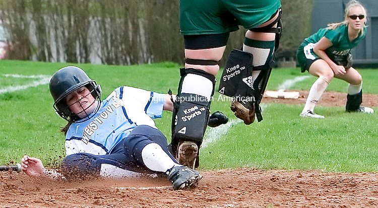 MIDDLEBURY, CT- 28 APRIL 07- 042807JT11-<br /> Westover's Emily Miranda slides safely into home as Hamden Hill pitcher Rachel Merriam jumps to catch the ball thrown by teammate Alexa DellaRocco in the background during Saturday's game at Westover.<br /> Josalee Thrift Republican-American