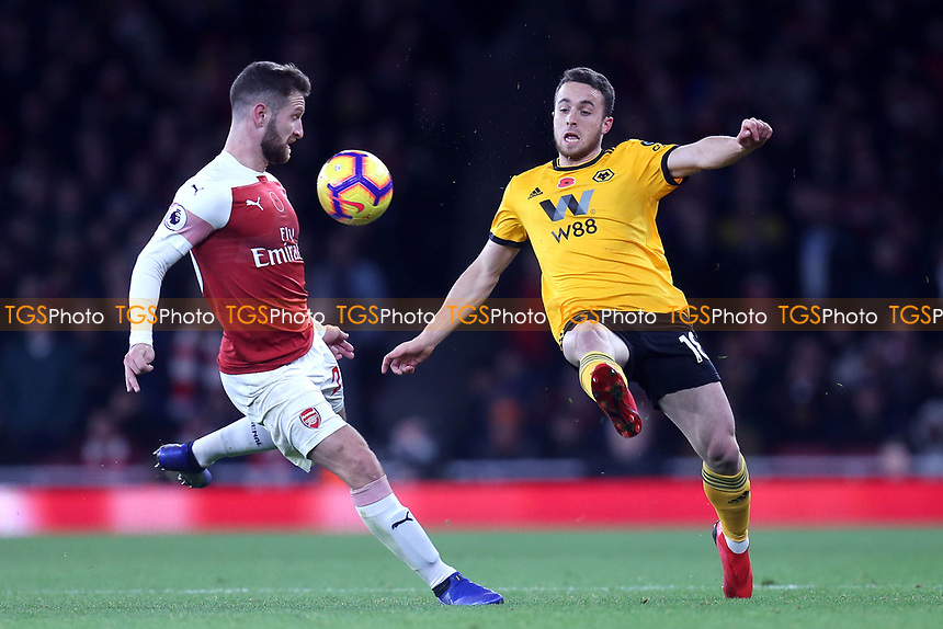 Diogo Jota of Wolves and Shkodran Mustafi of Arsenal during Arsenal vs Wolverhampton Wanderers, Premier League Football at the Emirates Stadium on 11th November 2018