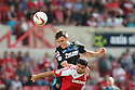 Greg Tansey of Stevenage challenges for a header with Yaser Kasim of Swindon<br />  Swindon Town v Stevenage - Sky Bet League One- The County Ground, Swindon - 10th August 2013<br /> © Kevin Coleman 2013