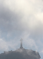 Rio de Janeiro. BRAZIL.  Christ the Redeemer, the Art Deco statue of Jesus Christ 2016 Olympic Rowing Regatta. Lagoa Stadium,  Rio de Janeiro, Brazil, Shrouded by low laying storm clouds <br /> Copacabana,  &ldquo;Olympic Summer Games&rdquo;<br /> Rodrigo de Freitas Lagoon, Lagoa.   Sunday  07/08/2016 <br /> <br /> [Mandatory Credit; Peter SPURRIER/Intersport Images]