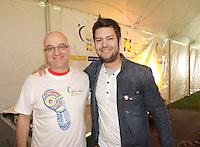 Montreal (QC) CANADA - June 8 2012 -  Relai pour la vie de la Societe canadienne du cancer  2012 - Montreal-Centre au Parc Maisonneuve - Dr Alain Vadeboncoeur (L), Maxime Charbonneau, MC