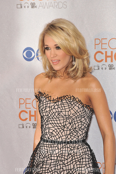 Carrie Underwood at the 2010 People's Choice Awards at the Nokia Theatre L.A. Live in Los Angeles..January 6, 2010  Los Angeles, CA.Picture: Paul Smith / Featureflash