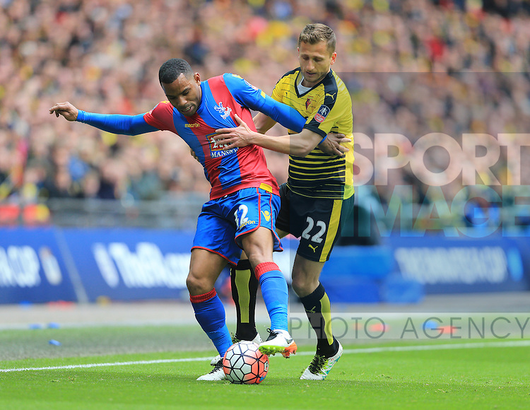 Crystal Palace's Jason Puncheon tussles with Watford's Almen Abdi during the Emirates FA Cup, Semi-Final match at Wembley Stadium, London.  Photo credit should read: David Klein/Sportimage