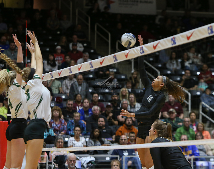 Rouse Raiders senior Dani Cole (10) attacks during the Class 5A high school volleyball state final between Rouse High School and Prosper High School at Curtis Culwell Center in Garland, Texas, on November 18, 2017. Prosper won the match in five sets, (25-18, 21-25, 18-25, 25, 23, 16-14) to win the 5A state championship.