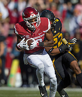 Hawgs Illustrated/BEN GOFF <br /> Jordan Jones, Arkansas wide receiver, evades Anthony Sherrils, Missouri strong safety, after catching a pass for 65 yards in the first quarter Friday, Nov. 24, 2017, at Reynolds Razorback Stadium in Fayetteville.