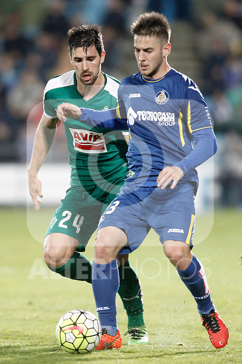 Getafe's Alvaro Medran (r) and Sociedad Deportiva Eibar's Adrian Gonzalez during La Liga match. March 18,2016. (ALTERPHOTOS/Acero)