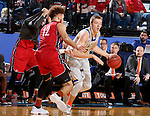 BROOKINGS, SD - DECEMBER 31:  Reed Tellinghuisen #23 from South Dakota State University drives against Trey Burch-Manning #12 from the University of South Dakota during their game Saturday afternoon at Frost Arena in Brookings. (Dave Eggen/Inertia)