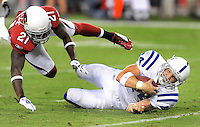 Sept. 27, 2009; Glendale, AZ, USA; Indianapolis Colts tight end Dallas Clark (44) is tackled by Arizona Cardinals safety (21) Antrel Rolle at University of Phoenix Stadium. Indianapolis defeated Arizona 31-10. Mandatory Credit: Mark J. Rebilas-