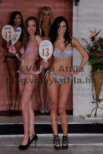 Renata Czinova (L) and Barbara Godo (R) participate the Miss Hungary beauty contest held in Budapest, Hungary on December 29, 2011. ATTILA VOLGYI