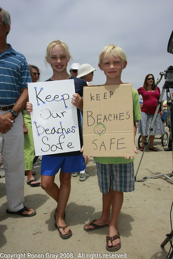 Summer (10) and Tanner (7) Ruane hold signs as Council Member Kevin Faulconer and Council President Scott Peters hold a joint press conference in Mission Beach Tuesday, July 22rd 2008.  Faulconer and Peters were there to announce that they will bring a proposal to put the ban on the November Ballot before the council at the next meeting.  Residents, business owners and media attended the rally with the overwhelming majority apparently in favor of the alcohol ban.