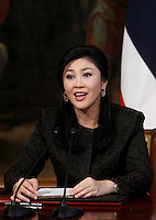 Il Primo Ministro thailandese Yingluck Shinawatra durante una  una conferenza stampa congiunta col Presidente del Consiglio a Palazzo Chigi, Roma, 11 settembre 2013.<br /> Thai Prime Minister Yingluck Shinawatra attends a joint press conference with the Italian Premier at the end of their meeting at Chigi Palace, Rome, 11 September 2013.<br /> UPDATE IMAGES PRESS/Isabella Bonotto