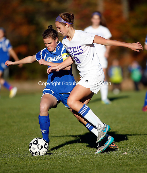 Burlington, CT- 23 October 2015-102315CM01- Nonnewaug's Maureen McCarthy, left, and Lewis Mills' Alyssa Wrabel go for the ball during their Berkshire League matchup in Burlington on Friday.     Christopher Massa Republican-American