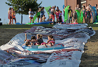 NWA Democrat-Gazette/BEN GOFF &bull; @NWABENGOFF<br /> Children take a turn down a roughly 150 yard waterslide on Saturday Aug. 1, 2015 at the home of Hutch Kufahl in Bentonville. Kufahl, youth pastor at First Baptist Church of Bentonville, organized the waterside as an activity for his Studio 412 high school youth group.