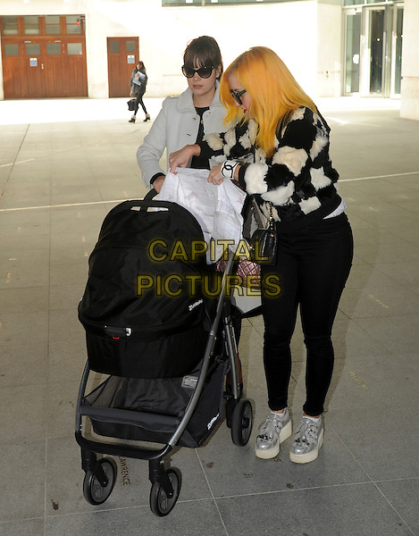 Lily Allen.Celebrities at BBC Radio 1 promoting Comic Relief Red Nose Day, London, England..March 14th, 2013.full length white grey gray black sunglasses shades buggy kid child baby mother mom mum check fur friend guest dyed yellow hair .CAP/AOU.©AOU/Capital Pictures.