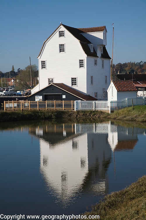 Tide mill pool reflection in mill pond Eiver Deben, Woodbridge, Suffolk, England. The present mill was built in 1793 on the site of more ancient mills and has been restored as a working mill and living museum.