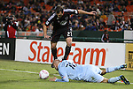 22 October 2011: DC's Daniel Woolard (21) is fouled by Kansas City's Aurelien Collin (FRA) (78). Sporting Kansas City defeated DC United 1-0 at RFK Stadium in Washington, DC in a 2011 regular season Major League Soccer game.