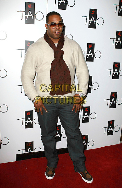 BUSTA RHYMES (Trevor Tahiem Smith, Jr.).hosts a night at Tao at the Venetian Resort Hotel and Casino, Las Vegas, Nevada, USA, 21st January 2010..full length brown burgundy scarf sunglasses grey gray trousers knitted knit cream jumper sweater Louis Vuitton logo trainers wrist watch bling bracelet .CAP/ADM/MJT.© MJT/AdMedia/Capital Pictures.