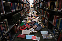 Unshelved books and damage in the UAA Consortium Library immediately following a 7.0 magnitude earthquake.