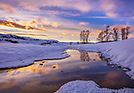 Yellowstone National Park, Wyoming/Montana: Colorful clouds reflected in the Lamar River at sunset in the Lamar Valley