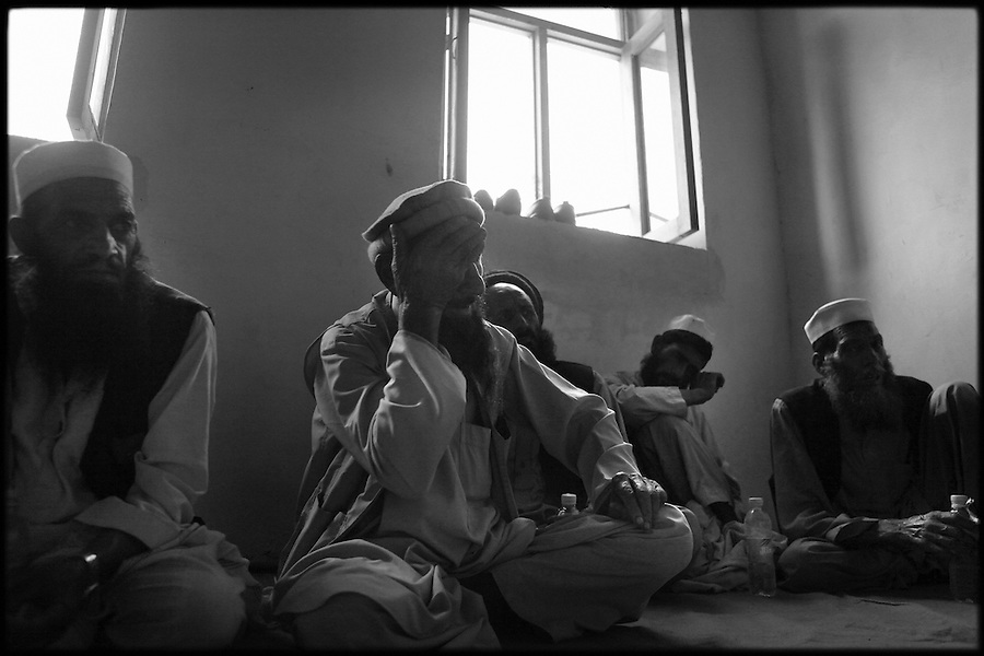 Soldiers from Baker Co. 2-12 Infantry Regiment 4th Brigade 4th Infantry Division listen to valley residents at a weekly shura in Afghanistan's Korengal Valley in the summer of 2009.