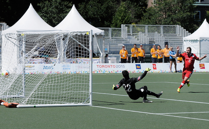 Toronto, ON - Aug 9 2015 -  Matt Brown of Canada celebrates a goal is scored past Marthell Vazquez of the  United States in the First Round of Football 7-a-side at the Parapan Am Fields during the Toronto 2015 Parapan American Games  (Photo: Matthew Murnaghan/Canadian Paralympic Committee)