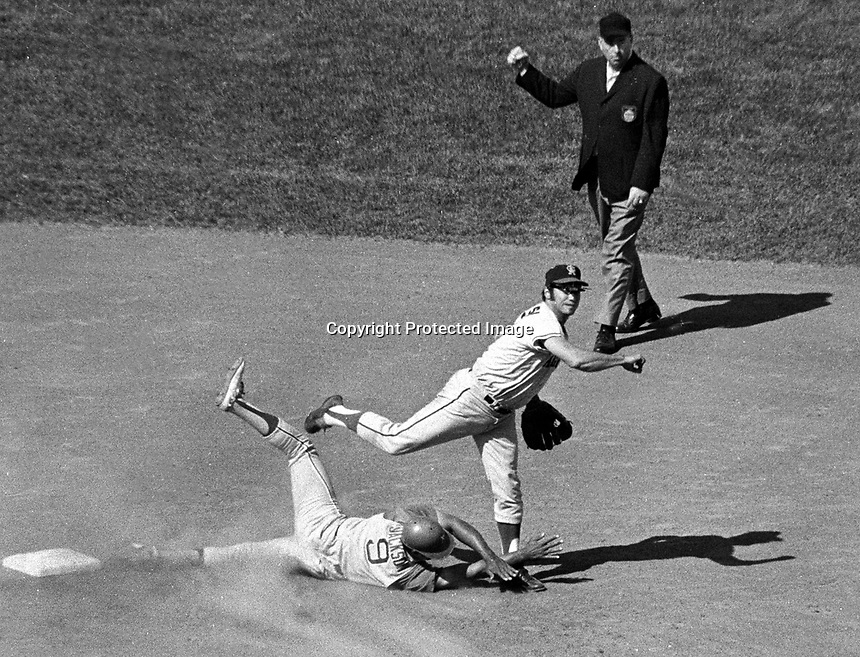 Angels short stop Jim Fregosi throw to first after the A's Reggie Jackson is out at 2nd. (1969 photo by Ron Riesterer)