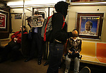 A man reads a news paper as he rides the subway in New York NY .Tuesday Nov 4 2008.  Millions of voters across the United States went to the polls in record numbers to choose between Presidential candidates Barack Obama and John McCain.. Photo by Eyal Warshavsky .