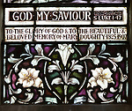 Stained glass window church of Saint Mary, Martlesham, Suffolk, England, UK by Heaton, Butler and Bayne early 1900s lilies floral decoration design detail
