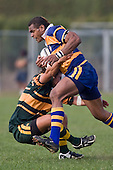 Simione Saravanua knocks Paul Ivamy backwards as he charges upfield. CMRFU Counties Power Premier Club Rugby game between Patumahoe & Pukekohe played at Patumahoe on April 12th, 2008..The halftime score was 10 all with Pukekohe going on to win 23 - 18.