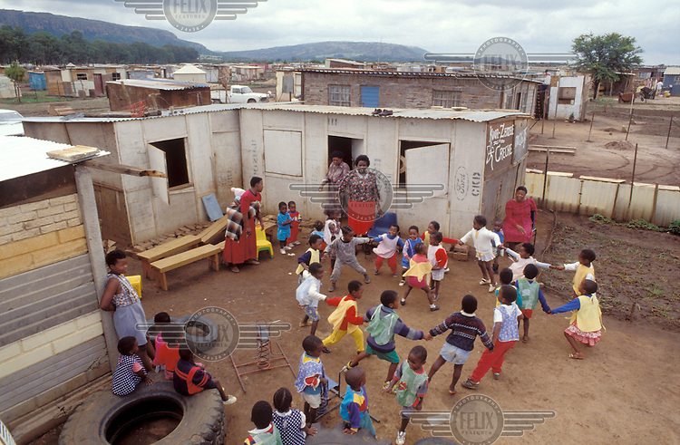 © Chris Sattlberger / Panos Pictures..Near Pretoria, SOUTH AFRICA..Kids in the playground of a creche in Mamelodi Township.