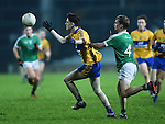 Joe Mc Gann of Clare  in action against AJ O Connor of Limerick during the Mc Nulty Cup U-21 final at The Gaelic Grounds. Photograph by John Kelly.