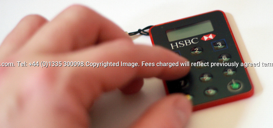 """27/02/2012. TODAY PHOTO...An HSBC customer uses a secure key device to access their online banking...HSBC's annual profits rose 15% to £13.8bn in what it called a year of """"major progress""""...The bank is the biggest in Europe and makes about 90% of its profits outside the UK...HSBC's UK profits were 17.2% higher than last year at £1.5bn....All Right Reserved - F Stop Press.  www.fstoppress.com. Tel: +44 (0)1335 300098.Copyrighted Image. Fees charged will reflect previously agreed terms or space rates for individual publications, states or country."""