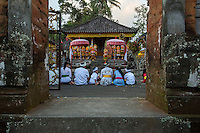 Bali, Indonesia.  Family at Hindu Temple to Pray for a Bountiful Rice Harvest.  Pura Dalem temple, Dlod Blungbang Village.
