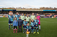 Tema captains line up with mascots and Referee James Adcock with his officials during the Sky Bet League 2 match between Wycombe Wanderers and Hartlepool United at Adams Park, High Wycombe, England on 26 November 2016. Photo by Andy Rowland / PRiME Media Images.