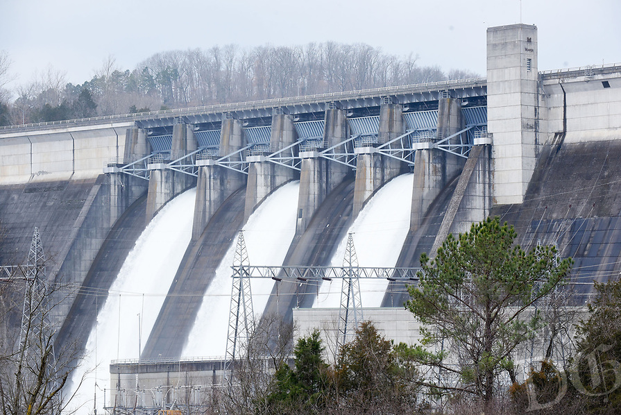 NWA Democrat-Gazette/FLIP PUTTHOFF <br /> BEAVER DAM RELEASE<br /> Water flows Wednesday March 20 2019 through three flood gates at Beaver Lake dam near Eureka Springs. The Army Corps of Engineers opened three of the seven flood gates six inches at 10 a.m. on Wednesday. Water is also being released through one hydroelectric generator. The dam's second generator is off line for repair. Total water release is 5,200 cubic feet per second, according to a corps' news release.