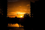 © Joel Goodman - 07973 332324 . No syndication permitted . 21/11/2013 . Manchester , UK . A fiery orange sunset over the River Irwell on the border between the two cities of Salford and Manchester , this evening ( Thursday 21st November 2013 ) . Photo credit : Joel Goodman