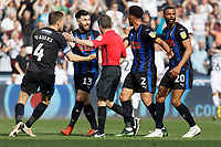 Rotherham United players protest to referee Keith Stroud (C) about an alleged handball committed before the goal scored by Kyle Naughton of Swansea City during the Sky Bet Championship match between Swansea City and Rotherham United at the Liberty Stadium, Swansea, Wales, UK. Friday 19 April 2019